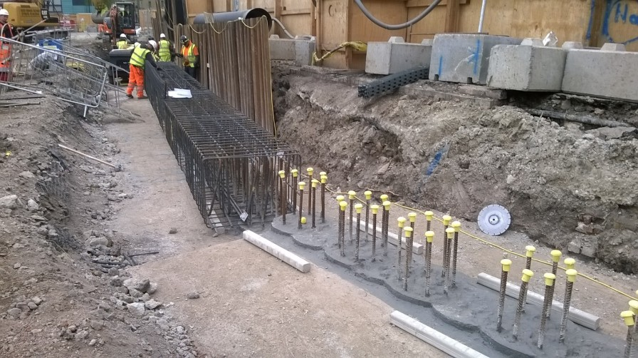 Basement wall capping beam construction in progress