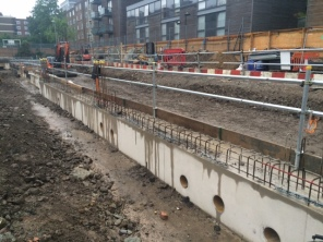 Basement wall capping beam construction completed