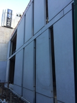 School cladding installation in progress.