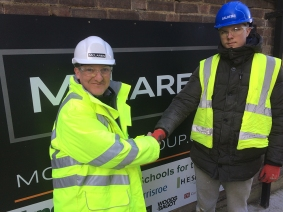 Project Director Gordon Wescombe (left) welcoming an apprentice bricklayer to the Nile Street project